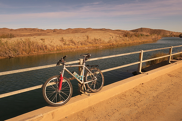 Biking bikes on dirt roads along irrigation canals in southwest Arizona.