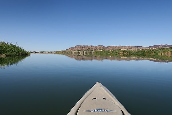Kayak fishing for largemouth bass on the Colorado River with watermanatwork.com