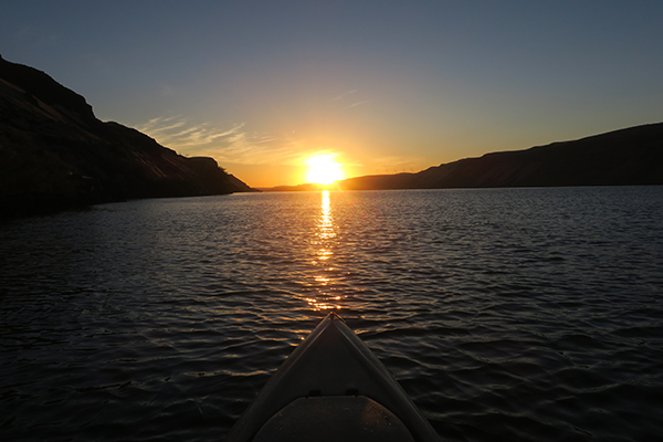 Sunrise on the Columbia River in eastern WA kayak fishing for smallmouth bass