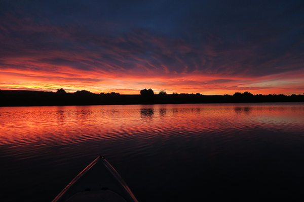 Colorado River sunrise. Kayak fishing with watermanatwork.com