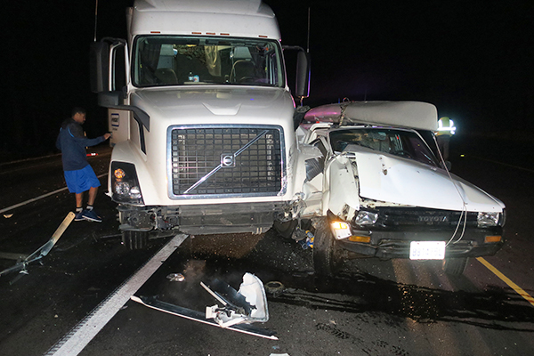 Rear ended by 40 ton semi doing 50mph while stopped for flagman in road construction zone