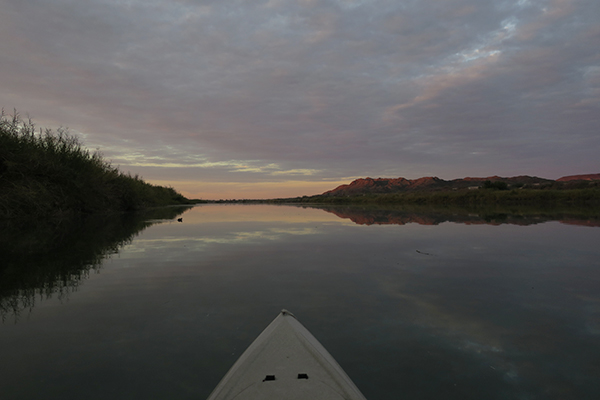 Calm overcast conditons kayak fishing for largemouth bass on the Colorado River