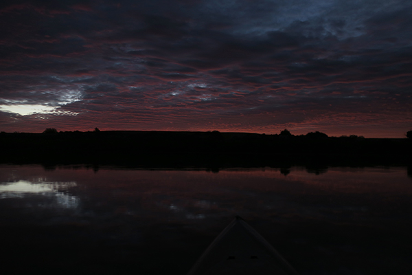 Kayak fishing with watermanatwork.com just before sunrise on a cloudy desert morning