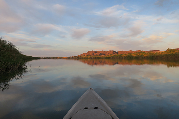 Kayak fishing at sunrise on the Colorado River with watermanatwork.com
