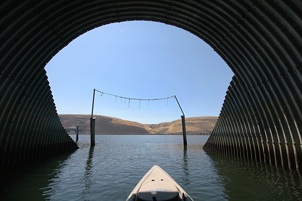Kayaking through a culvert on the Columbia River