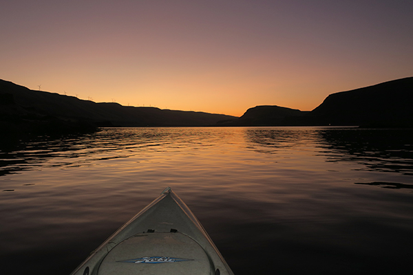 Kayak fishing before sunrise on the Columbia River in eastern Washington