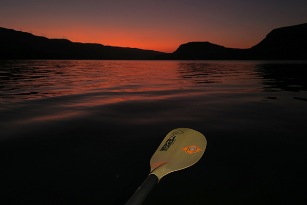 Kayak fishing on the Columbia River on a hot summer moorning with watermanatwork.com