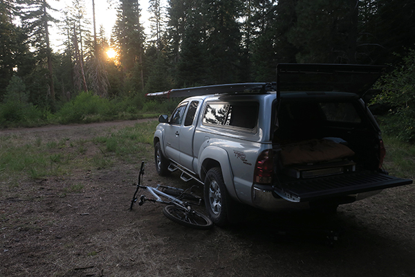 Mountain bike camping in the Cascade Mountains at sunset with watermanatwork.com