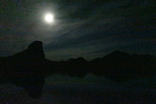 Kayak fishing for largemouth bass by the light of the full moon