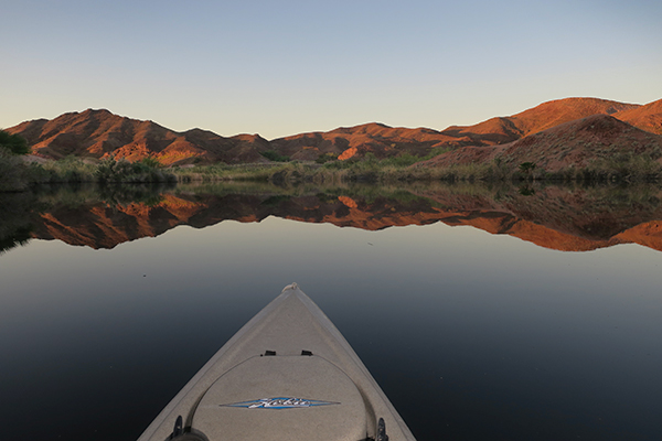 Kayak fishing at sunrise on the backwaters of the Colorado River