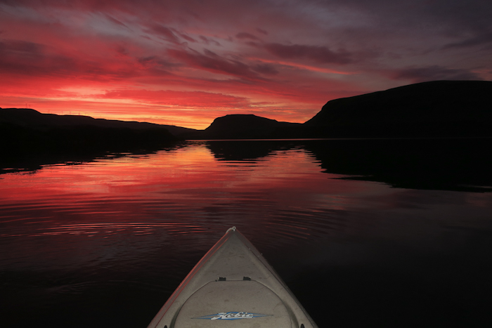 Kayak fishing on the Columbia River at sunrise with watermanatwork.com