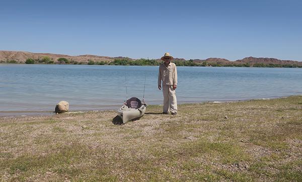 Kayak fishing in extreme desert heat with watermanatwork.com kayak fisherman Ron Barbish