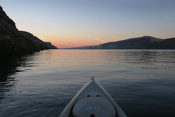 Kayak fishing on the Columbia River at sunrise