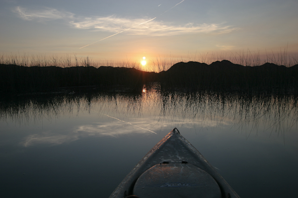 Kayak fishing at sunrise on the Colorado River