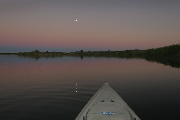 Kayak fishing under a full moon on the Colorado River