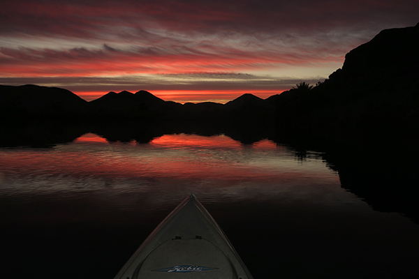 Kayak fishing on the Colorado River before sunrise