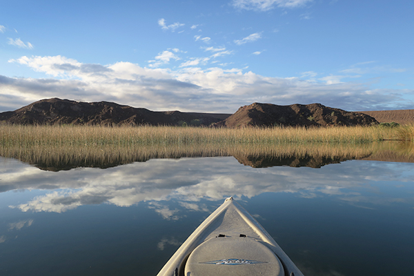 Kayak fishing just after sunrise on the Colorado River