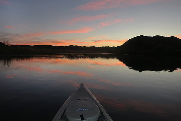 Kayak fishing at dawn on the Colorado River